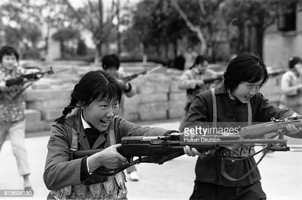 Young members of the Maoist Red Guard armed with bayonet rifles