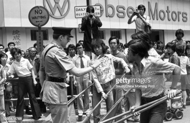 Young members of the Marxist Revolutionary League defy the police order to disperse 29APR77