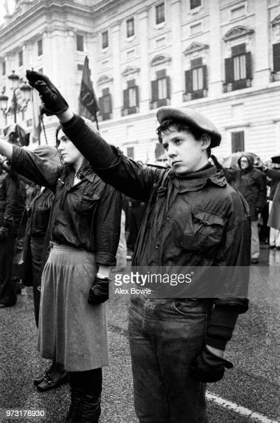 Young members of the neo-fascist Fuerza Nueva Party give the Nazi salute to commemorate the 2nd anniversary of Franco's death outside the former...