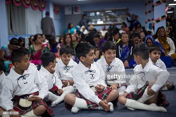 Young members of the Shree Muktajeevan Pipe Band sit in the temporary prayer hall at the Shree Swaminarayan Mandir a major new Hindu temple being...