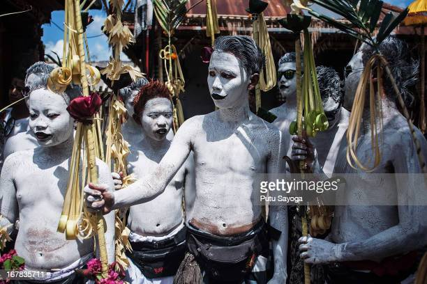 Young members of the village community gather at Duur Bingin temple before walk ing around their village with painted bodies during the Grebeg Ritual...