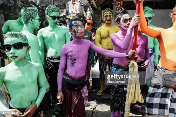 Young members of the village community gather at Duur Bingin temple before walking around their village with painted bodies during the Grebeg Ritual...