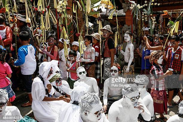 Young members of the village community gather at Duur Bingin temple before walking around the village with their bodies painted during the Grebeg...