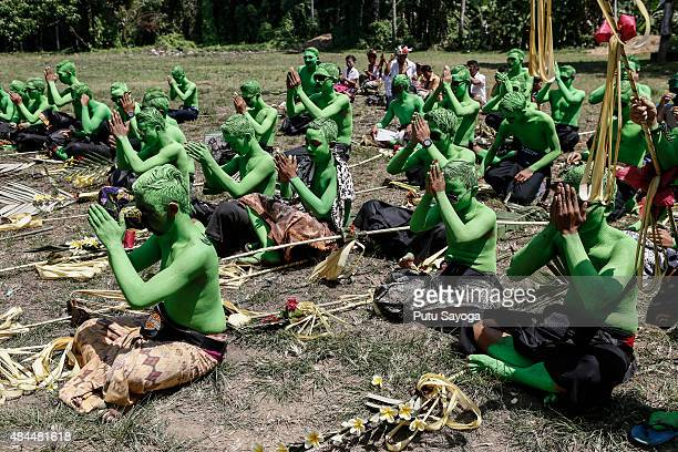 Young members of the village community pray during the Grebeg Ritual on August 19 2015 in Tegallalang village Gianyar Bali Indonesia During the...