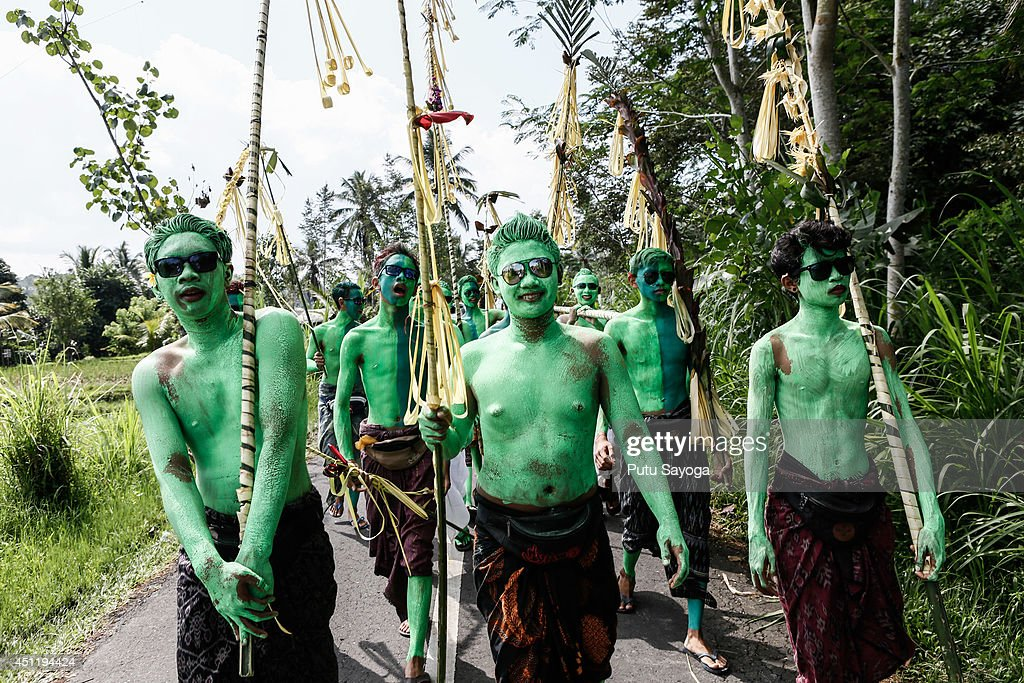 Young members of the village wait the Grebeg Ritual begin on June 25, 2014 in Tegallalang Village, Gianyar, Bali, Indonesia. During the biannual ritual, young members of the community parade through the village with painted faces and bodies to ward off evil spirits