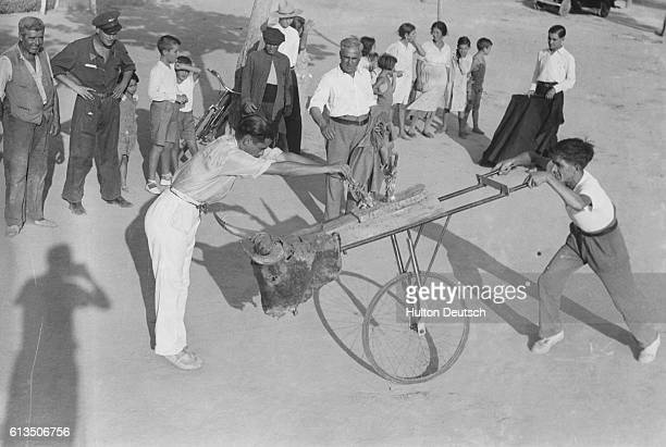 Young men and boys at a Bullfighting school in Seville Spain in 1936 Most of Spain's famous toreadors trained at this school Here two young pupils...