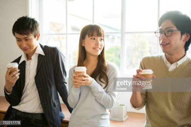 Young men and woman having coffee