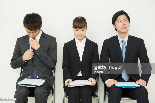Young men and woman sitting on chair