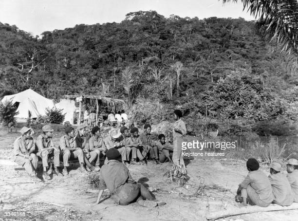 Young men and women attending a politicalmilitary instruction centre set up by the MPLA in Angola