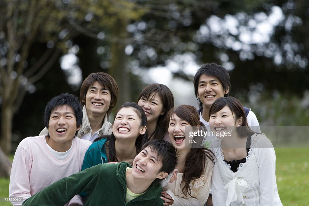 Young Men and Women Looking Up and Laughing, Front Focus,  : Stock Photo