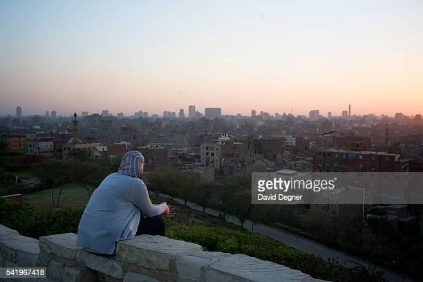Young men and women visit AlAzhar park above the city before breaking the fast on June 10 2016 in Cairo Egypt LongDescriptionForAllPhotos