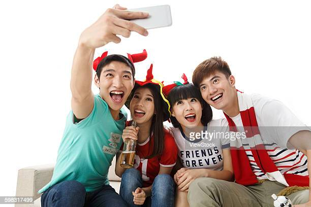 Young men and women with mobile phone