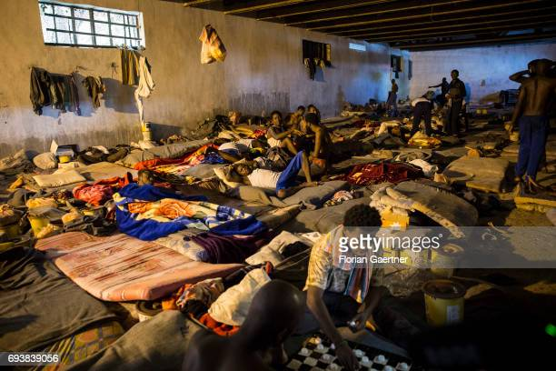Young men are pictured in a Detention Center on June 08, 2017 in Tripolis, Libya. A detention center place where illegal migrants are arrested.
