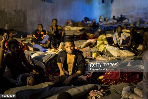 Young men are pictured in a Detention Center on June 08 2017 in Tripolis Libya A detention center place where illegal migrants are arrested