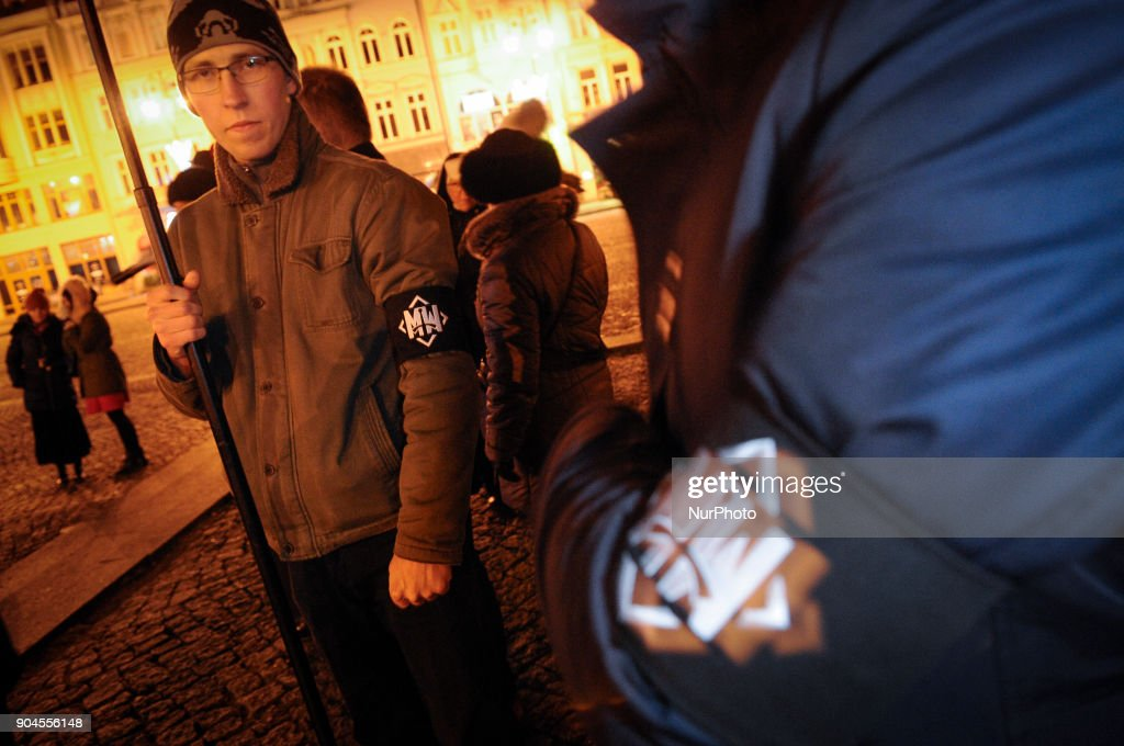 Young men are seen wearing armbands of the All-Polish Youth or Mlodziez Wszechpolska in Bydgoszcz, Poland on January 13, 2018. The nationalist group is reknowned for its homophobia and violent treatment of opponents at rallies. On Saturday a rosary was held on the Old Market Square for the renewal of the moral of the Polish nation, an anti-abortion rally attended by several dozen people.