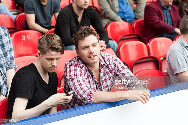 young men at football match - football fan stock photos and pictures