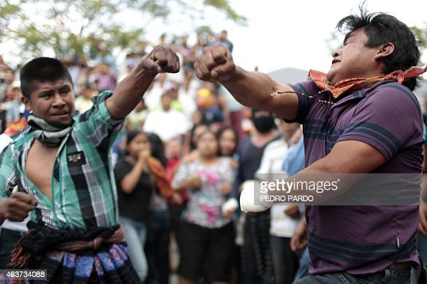 Young men attempt to hit each other in a fight representing the Xochimilcas fight to defend their women against the Aztecs in the Mexican...