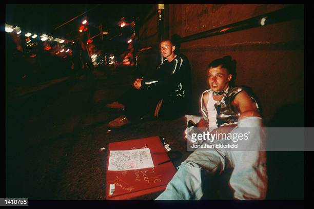 Young men beg for money at Cooper Square in the East Village June 1 1998 in New York City Populated by residents of numerous heritages including...
