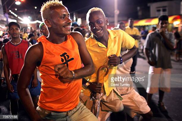 Young men dance in the streets during Carnival on February 7, 2005 in Salvador, Brazil. Centuries of slave trade with Central and West Africa has...