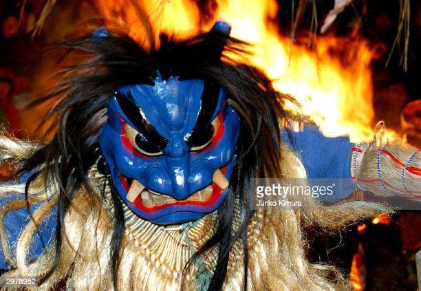 Young men disguised as ogres appear at Shinzan shrine during Namahage Festival February 13 2004 in Oga Japan The festival is meant to ward off bad...