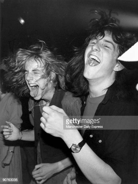 Young men enjoying rock music
