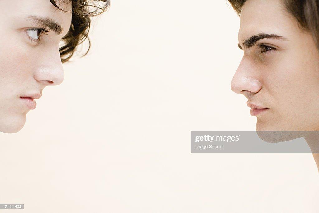 Young men face to face : Stock Photo