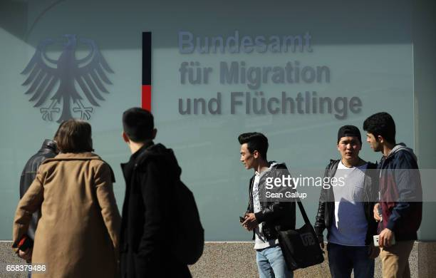 Young men from Afghanistan who were arriving to participate in a demonstration against deportations gather near the Federal Office for Migrants and...