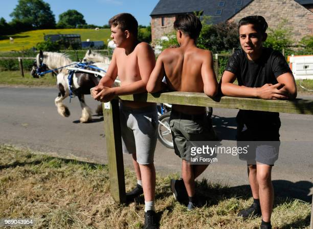 Young men from Birmingham stand and watch the horses on the first day of the Appleby Horse Fair on June 7 2018 in Appleby EnglandThe fair is an...