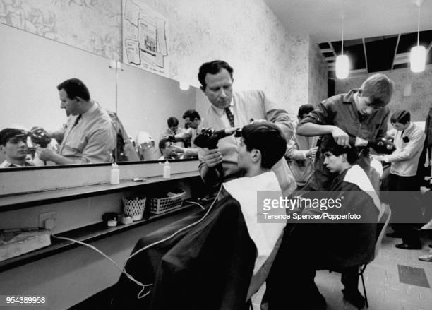Young men getting Beatles' haircuts at a local barbershop, London, United Kingdom, November 1963.
