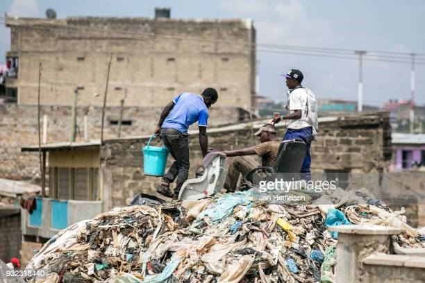 Young men had a break on the Dandora rubbish dump on March 14 2018 in Nairobi Kenya The Dandora landfield is located 8 Kilometer east of the city...