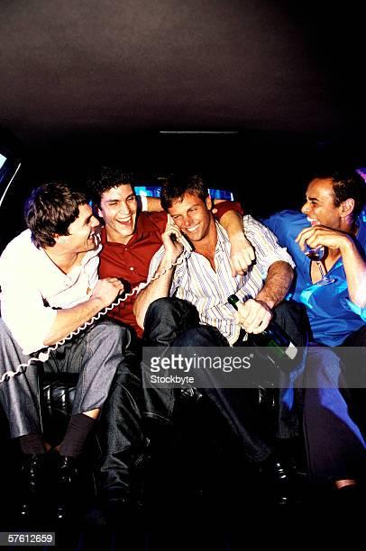 Young men having fun inside a limousine