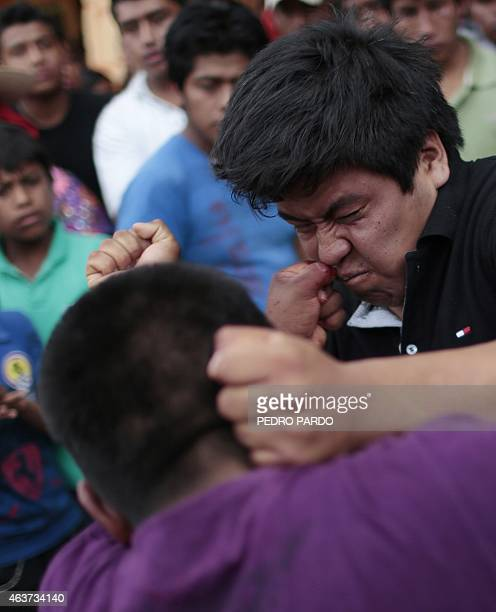 Young men hit each other in a fight representing the Xochimilcas fight to defend their women against the Aztecs in the Mexican municipality of...
