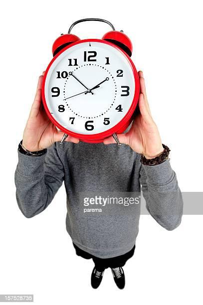 Young men holding alarm clock.