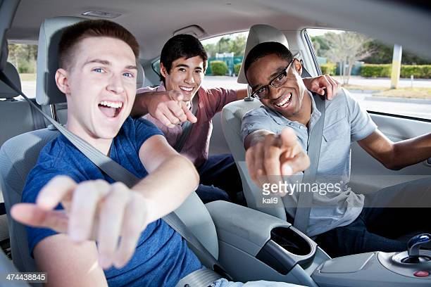 Young men in car