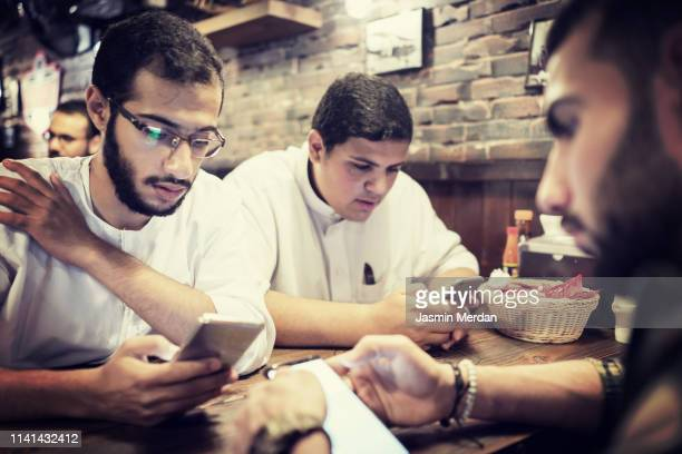 young men in fast food restaurant - iftar stock pictures, royalty-free photos & images
