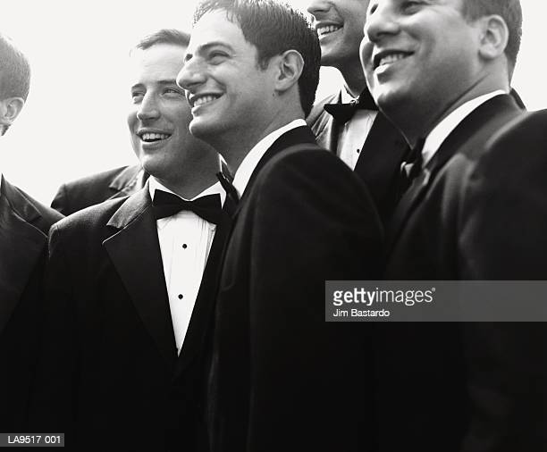 young men in tuxedos (b&w) - smoking stock-fotos und bilder