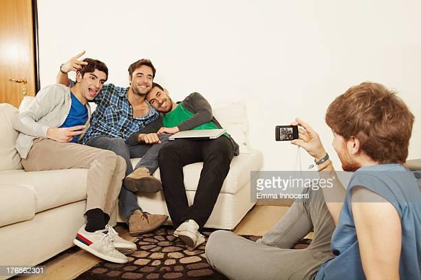 young men indoor taking snapshot photographs - 若い男性だけ ストックフォトと画像