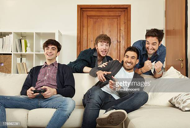 young men indoors playing video games - 若い男性だけ ストックフォトと画像