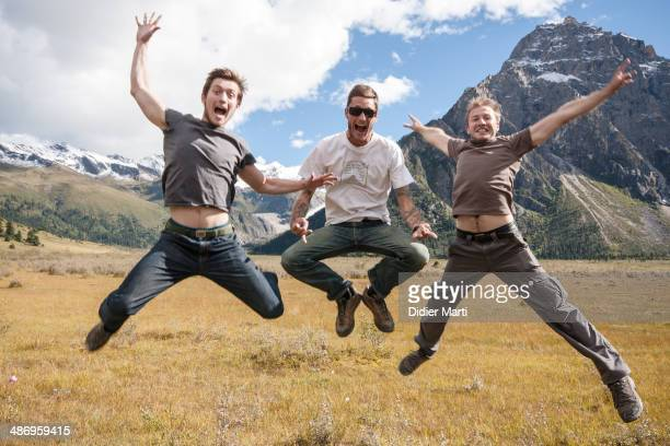 3 young men jumping near Yilhun Lhatso lake in Dege county in Sichuan province in China