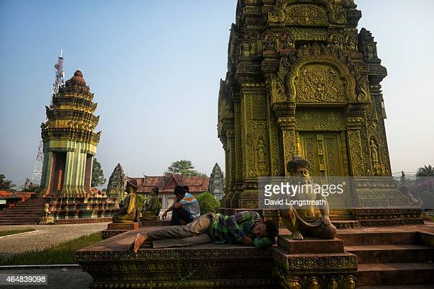 Young men lounge near a temple complex Monday Feb 16 2015 A stable Cambodia has meant that each year since records were kept in 1993 the number of...