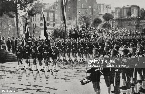 Young men of Hitler Youth marching in front of the Duce Benito Mussolini in Via dei Fori Imperiali Rome Italy to show their common ideals with the...