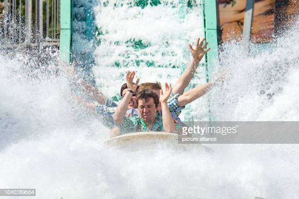 Young men on a wild water slide at the Gaeubodenvolksfest folk festival in Straubing, Germany, 8 August 2015. Around 1.4 million visitors are...