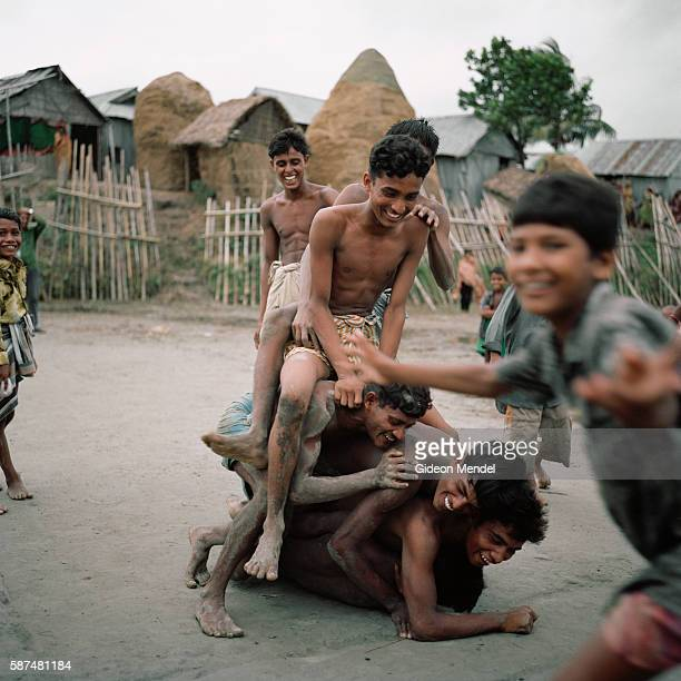 Young men play an informal game of kabaddi on the shoreline of the island of Aralia The game is popular throughout South Asia and is the national...