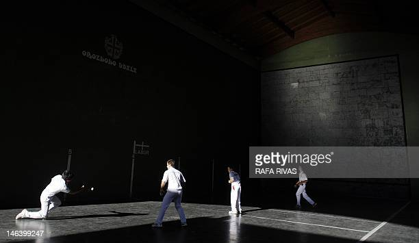 Young men play Basque traditional Esku Pilota on June 15 at a court of the Northern Spanish Basque village of Orozko AFP PHOTO/ RAFA RIVAS