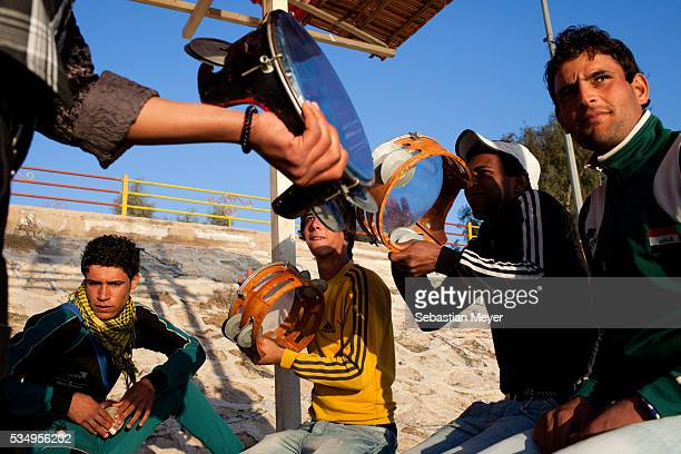 Young men play music on the banks of the Tigris in the Abu Nawaz district of Baghdad After years of war and violence Baghdad is starting to show...