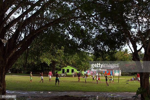Young men play soccer at Trancoso daily life in village Bahia State Brasil