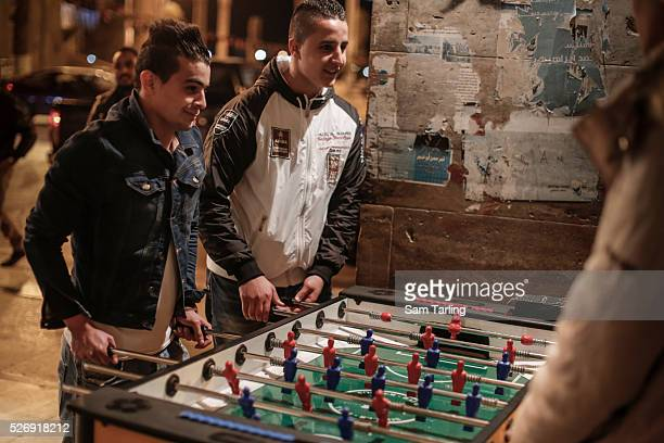 Young men play table football in Tripoli's Martyr's Square, on March 5th, 2015. Although a vibrant daily life is very much in evident in the nation's...