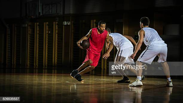 young men playing basketball - basketball team stock pictures, royalty-free photos & images