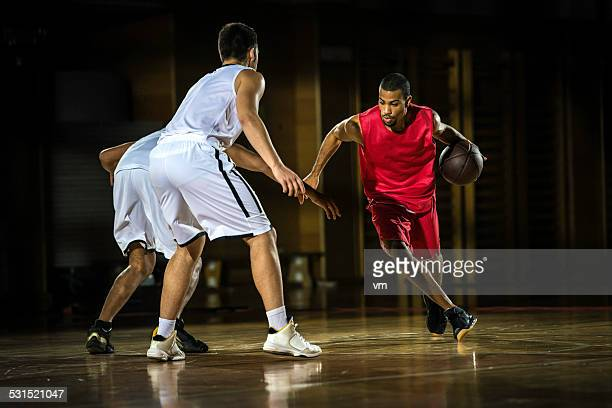 young men playing basketball - sports league stock pictures, royalty-free photos & images