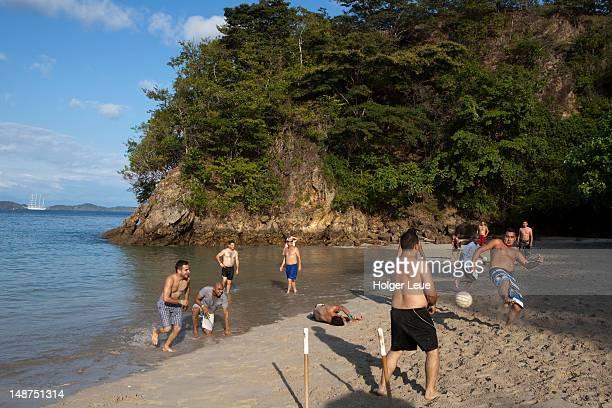 young men playing beach soccer. - ビーチサッカー ストックフォトと画像